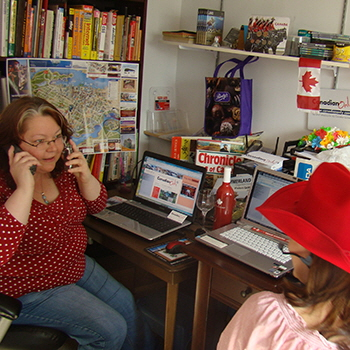 Annie and Pam juggling tasks in our busy little office back in 2010